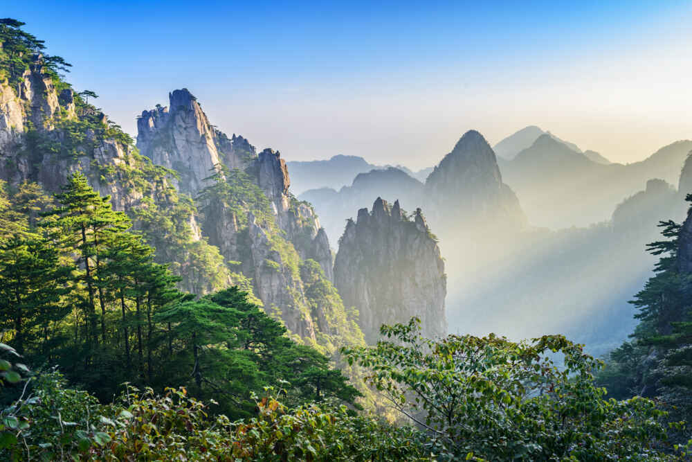 Huangshan, the Yellow Mountains, in Anhui Province, China - sunset on huangshan - Backyard Travel