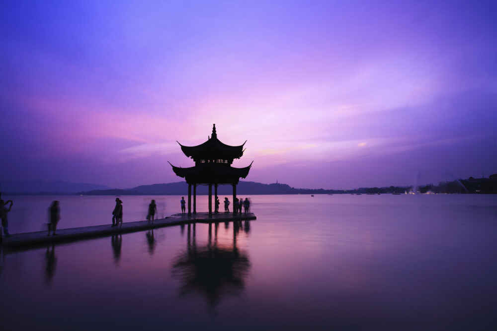 Temple on Hangzhou lake at sunset, China - Backyard Travel