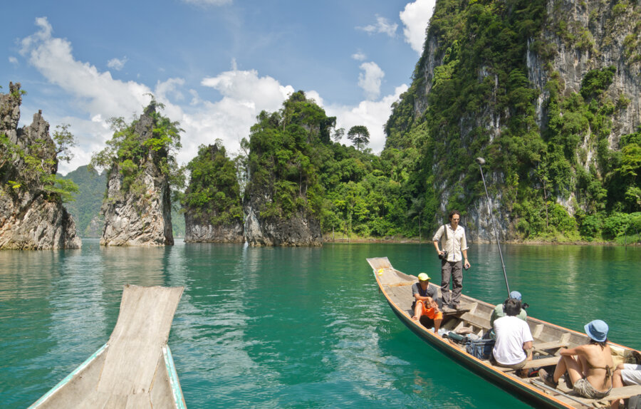 travelers visiting khao sok national park on a boat with private guide