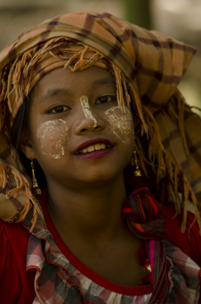 Burmese girl with thanaka on her face