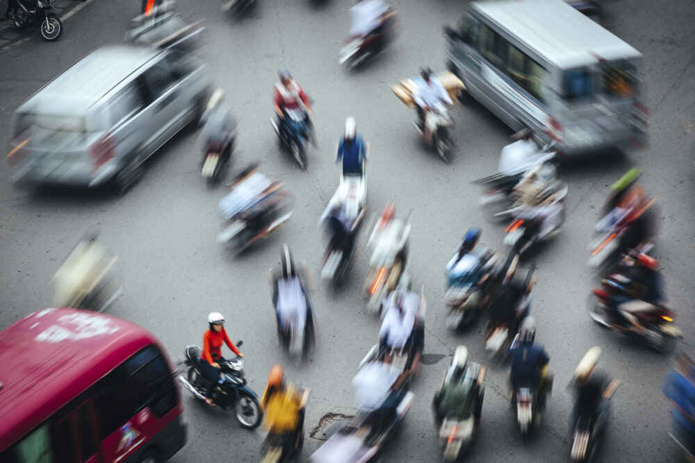 motion blurred motorcycle in the street of Hanoi Vietnam