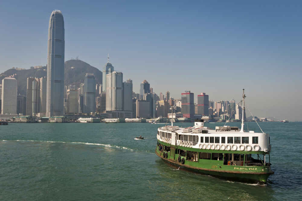 Hong Kong Star Ferry in Victoria harbour with skyscraper