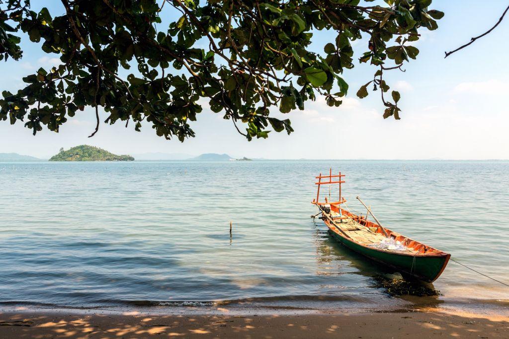 Cambodia, Kep Province, Koh Tonsay, boat on beach.