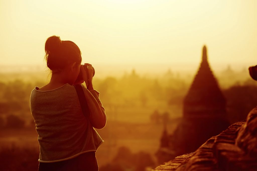 Best Time to Visit Bagan: tourist girl taking picture of sunset