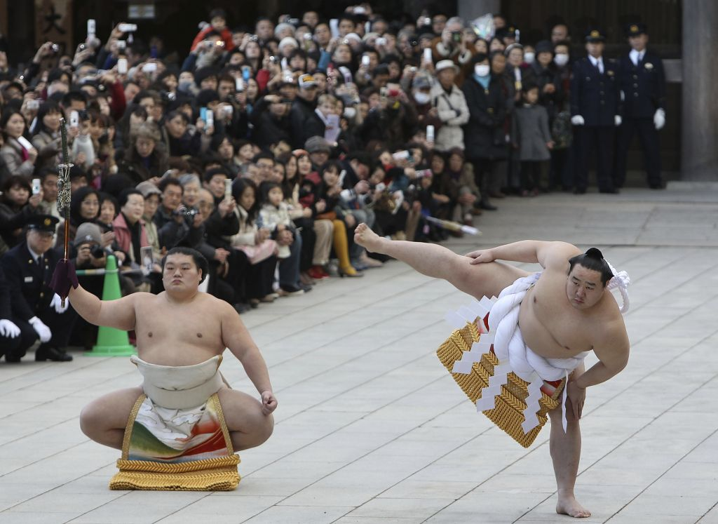 Sumo is one of the best travel experiences to have in Asia: wrestlers waiting on tatami to fight