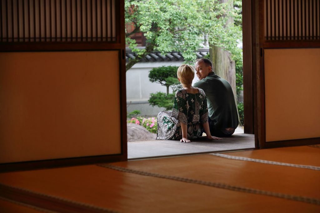 Honeymoon in Asia: Western couple relaxing in Japanese temple