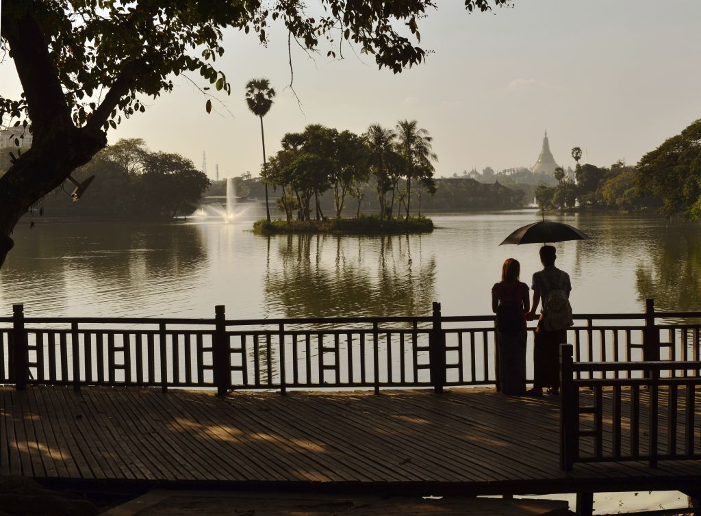Myanmar luxury holidays: couple looking the sunset in Yangon