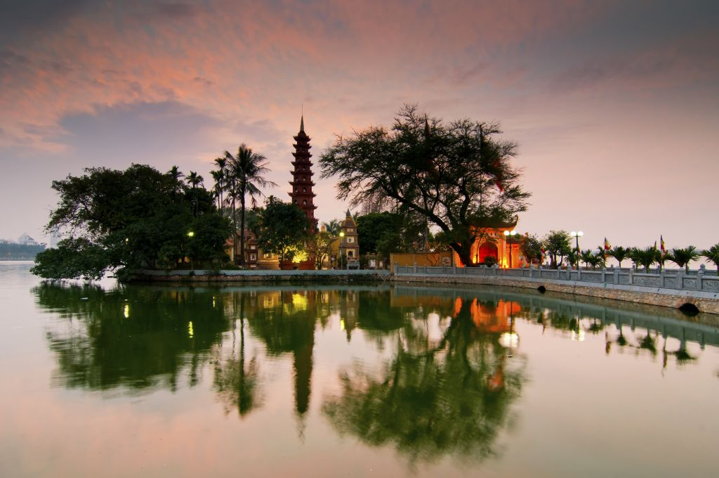 Vietnam family holiday tour: lake and temple in Hanoi during sunset