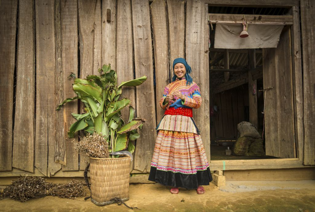 Facts about Vietnam: it is always a good time to visit the country - a flower Hmong woman smiling