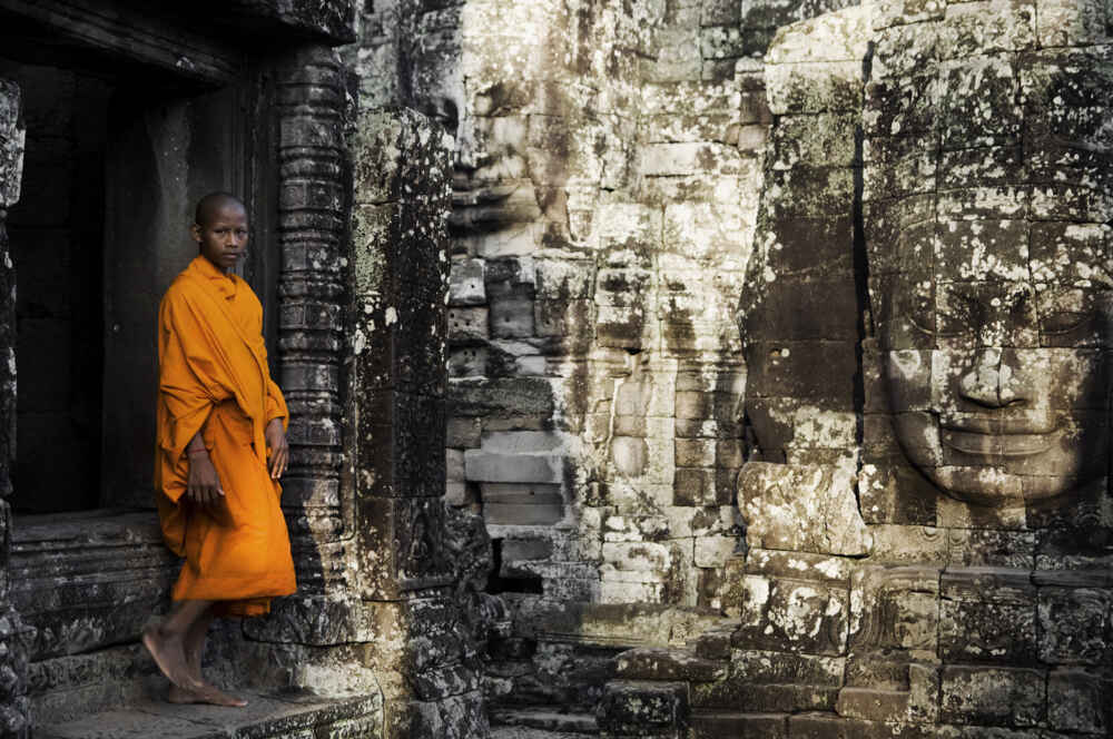 Cambodia Contemplating monk Angkor Wat multi country holidays in asia