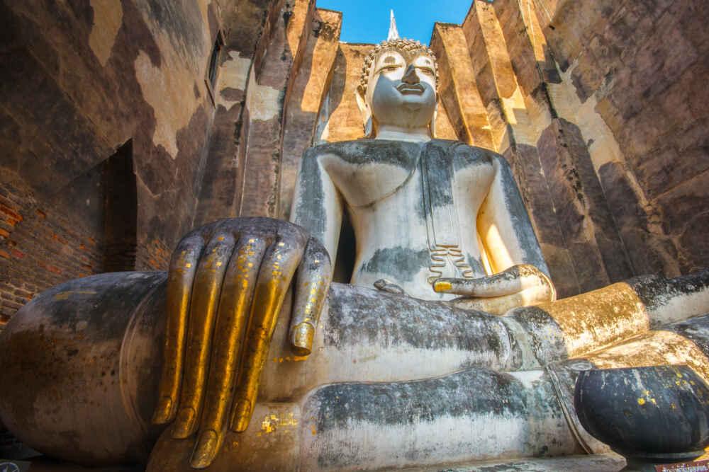 Ancient buddha statue Sukhothai Historical Park Thailand