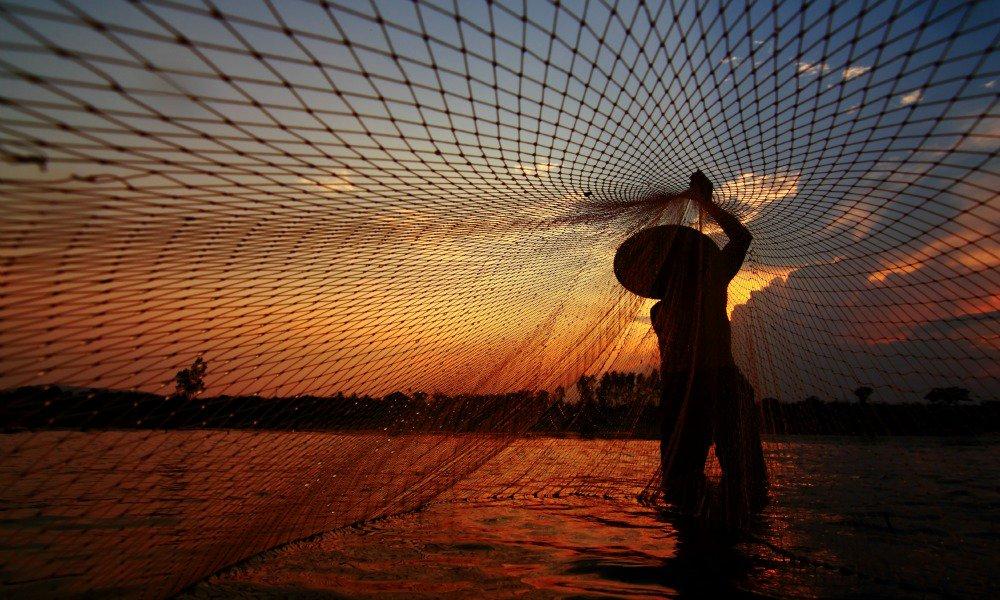 Mekong Delta family tour: fishermen in sunset