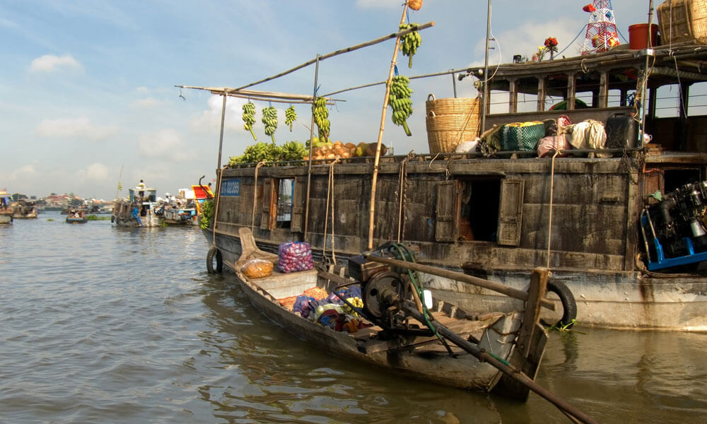 overnight Mekong cruise: A boat with Fruits on the floating market