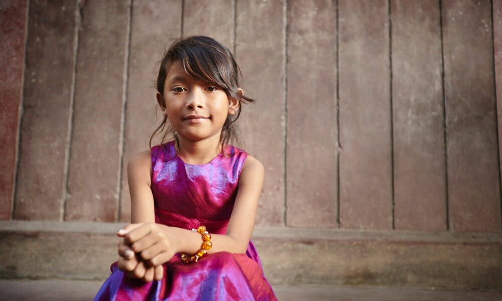 Cambodian girl dressed in pink dress