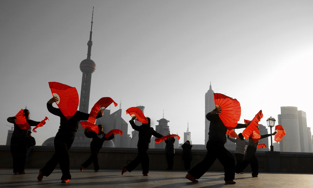 custom China tours: people performing a dance on the bund, in Changhai