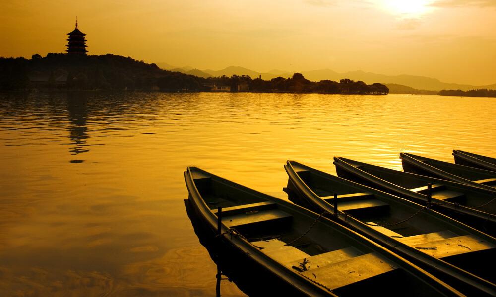 Boats and lake at Sunset at Hangzhou in china