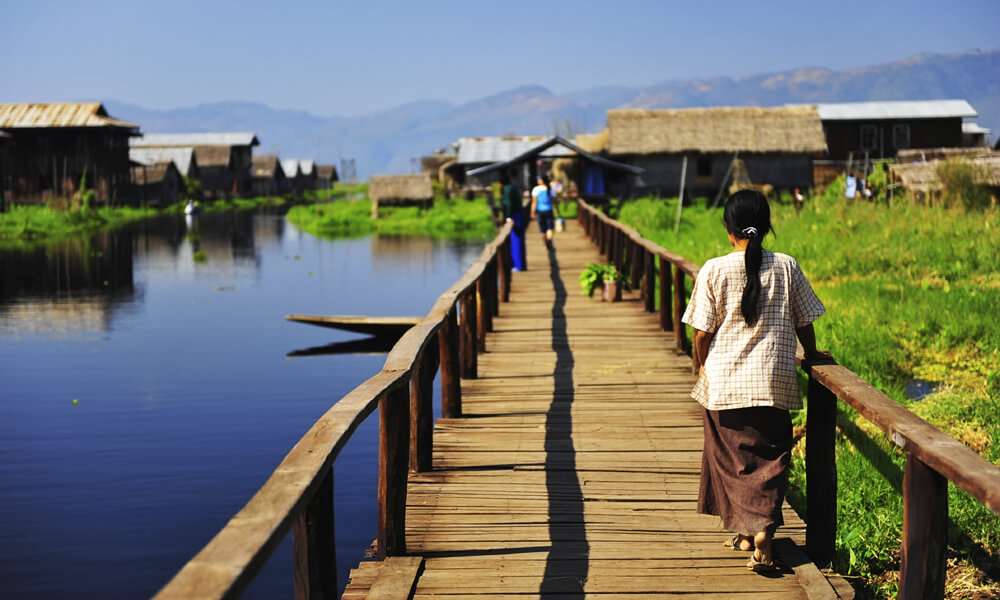woman walk in a wood way on Inle lake