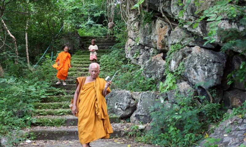 Grand tour of Indochina: local monks in the jungle temple
