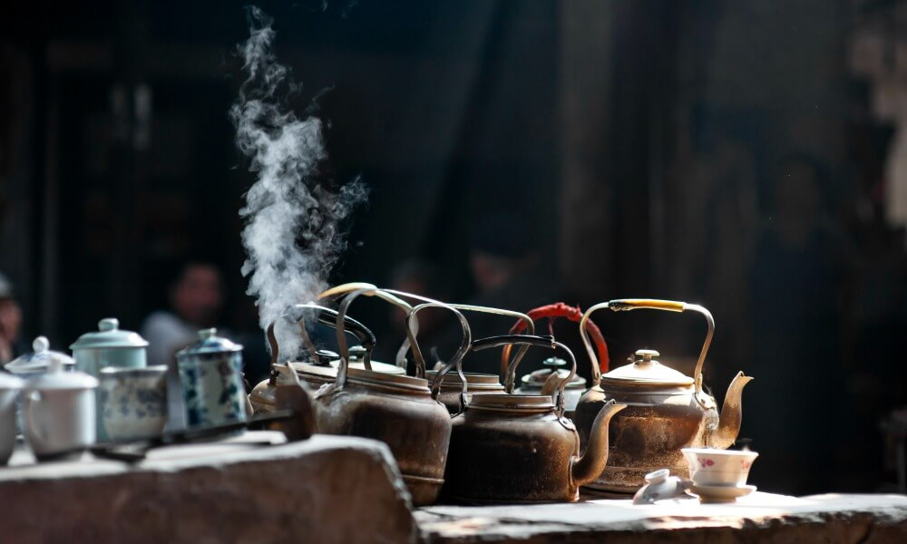 Chengdu Kettles on stove in old tea house Chengdu