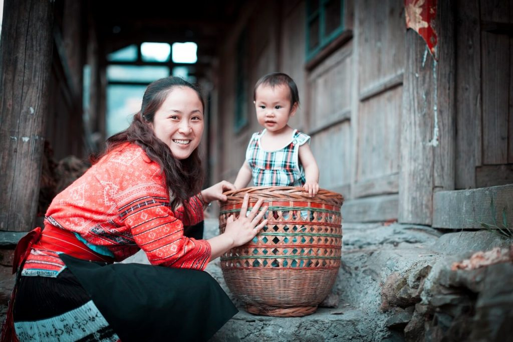 Yunnan by train: mother and child from Chinese Yao Tribe