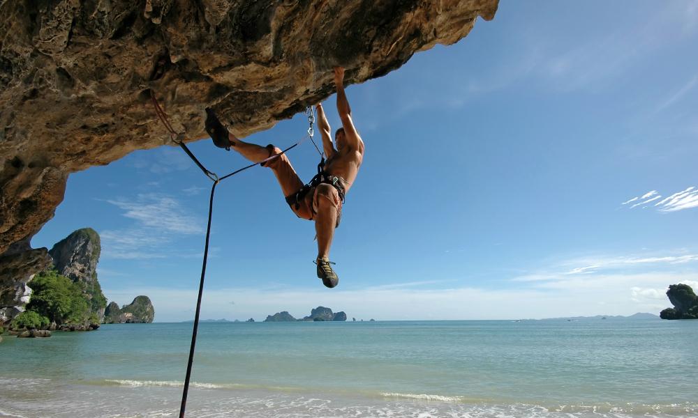 Krabi beach holiday: Men climbing on the mountain