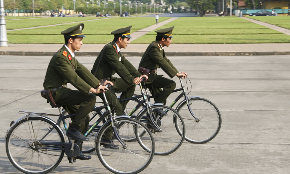 Vietnam private tour: Vietnamese military on bikes