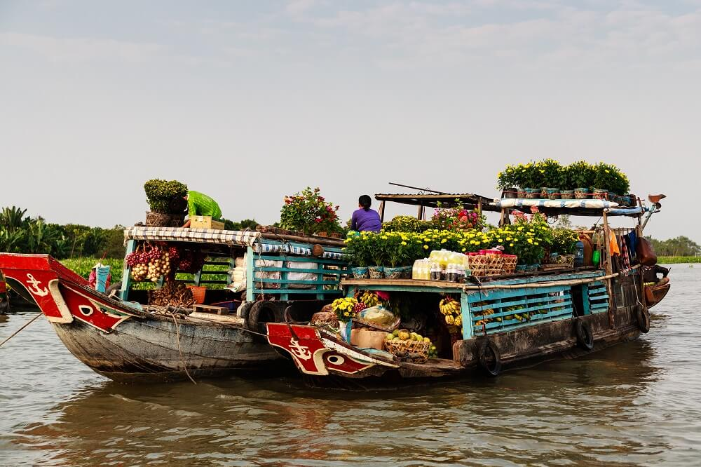 Cai be floating market in the mekong delta