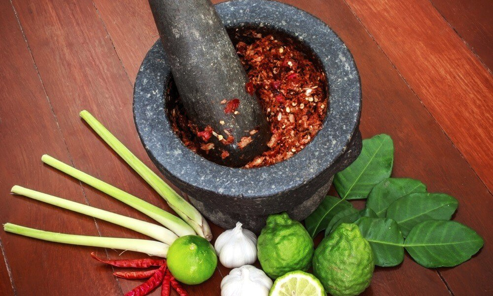 family holiday in Thailand: chilies smashed on a stone pot