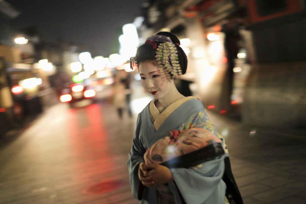 Kyoto Japan A geisha in traditional kimono walking in Gion Kyoto at night