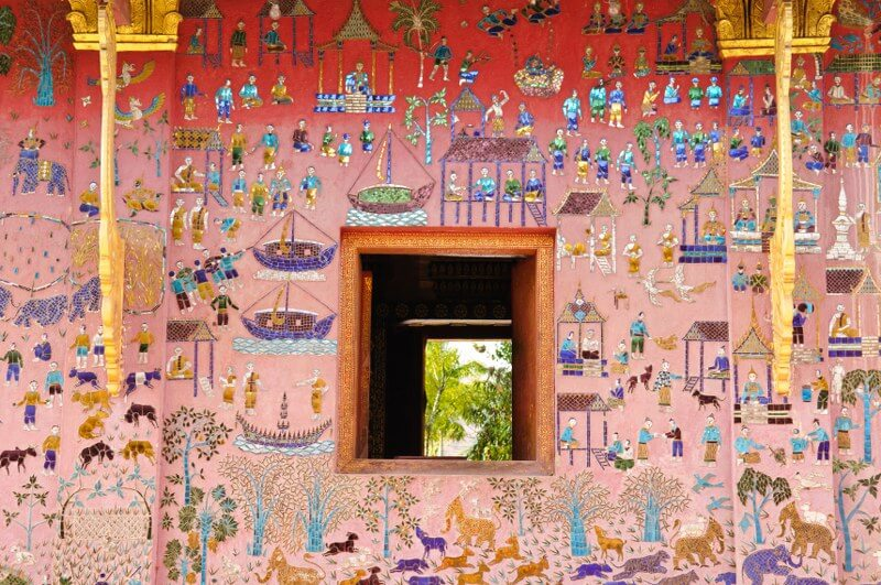 Grand tour of Indochina: hand paintings on temple wall showing cultures