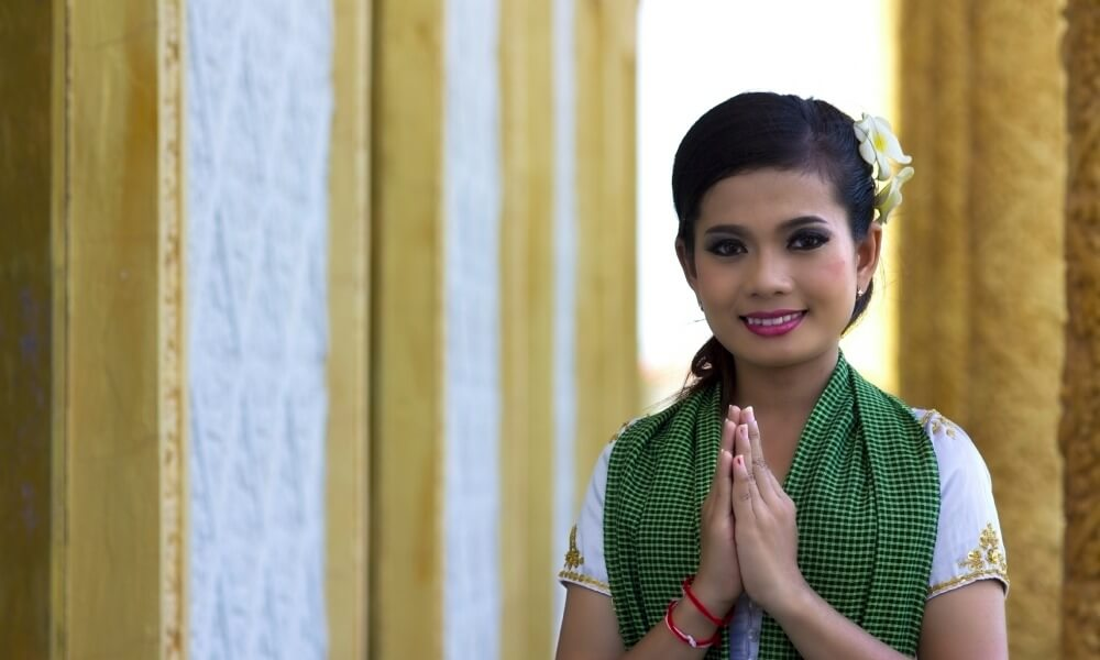 Sustainable Cambodia tour: Local woman greets in traditional way