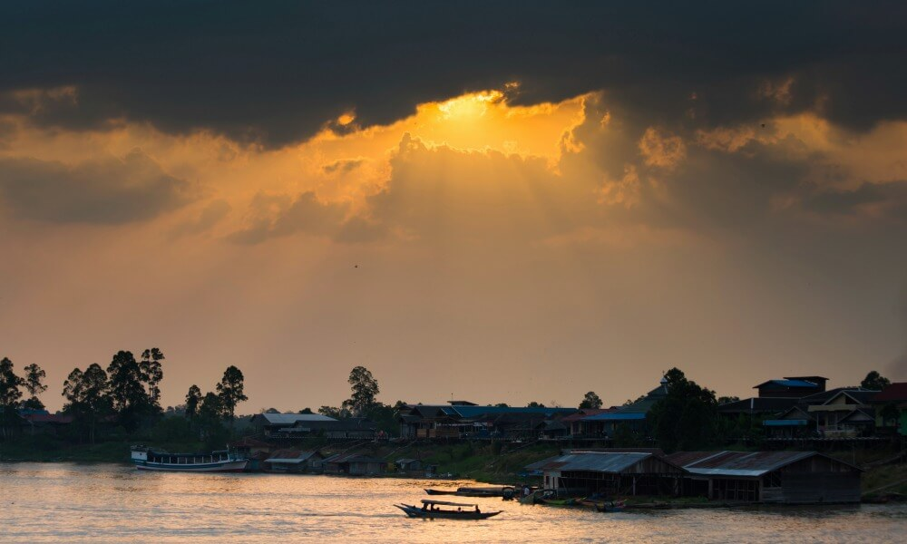 Borneo culture and cuisine: long houses along the river