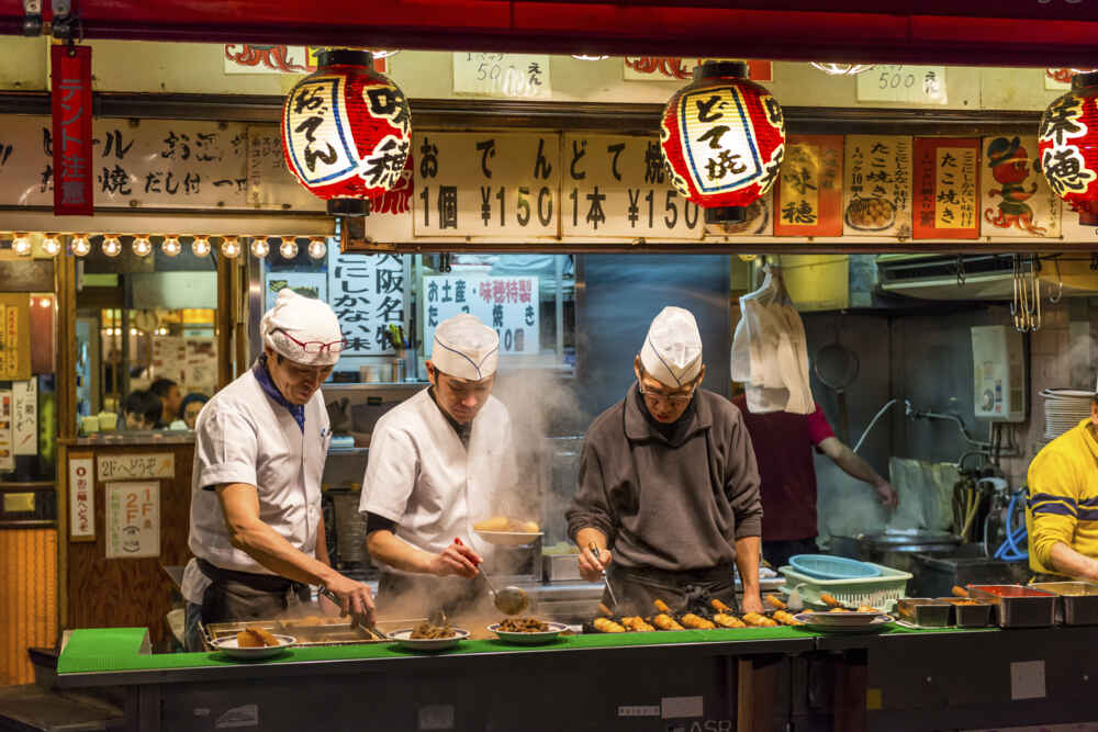Men cook traditional Japanese street food