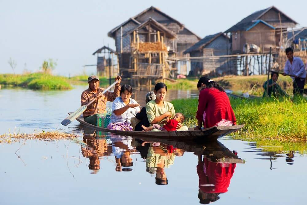 family in a boat at Inle Lake