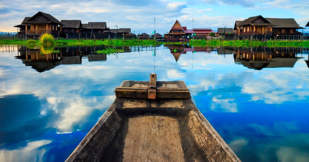 boat and floating houses in inle lake during the dar
