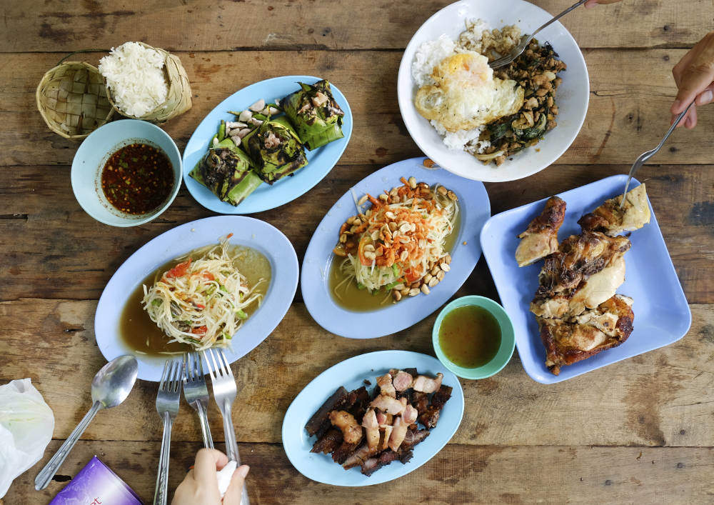 Many plates of local food on Isaan culinary tour
