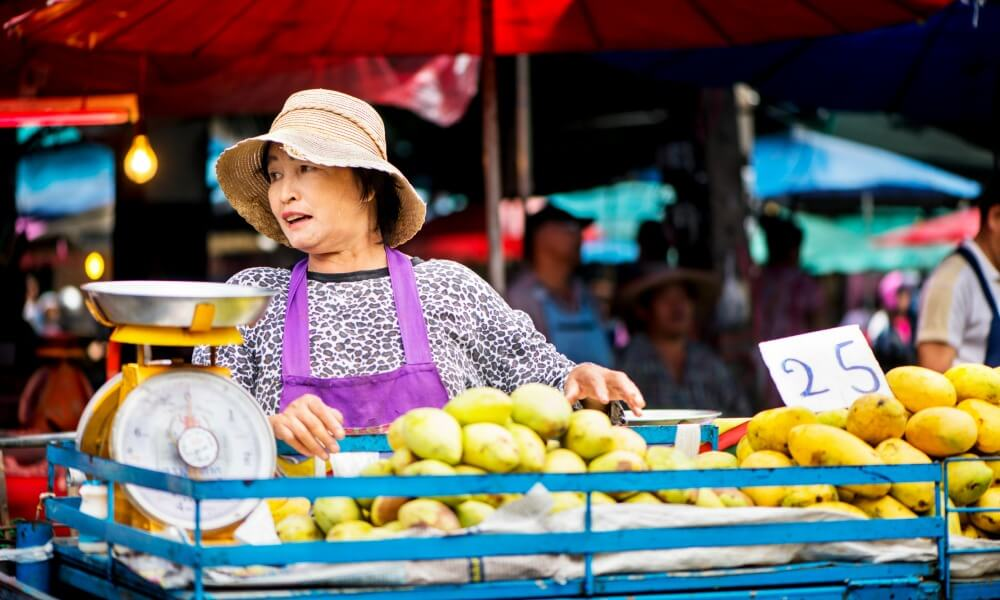 Womanm selling fruits in Thailand food tour