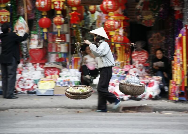 Grand tour of Indochina: local selling food on the street
