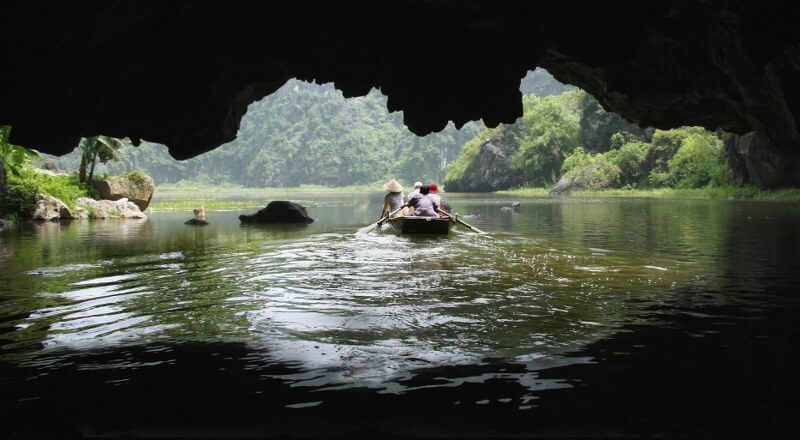 Grand tour of Indochina: paddling through the cave by local wood boat
