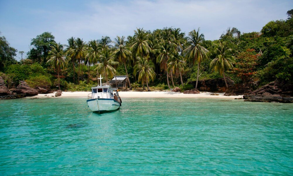 Phu Quoc Beach Holiday: boat parking on beautiful island with clear water
