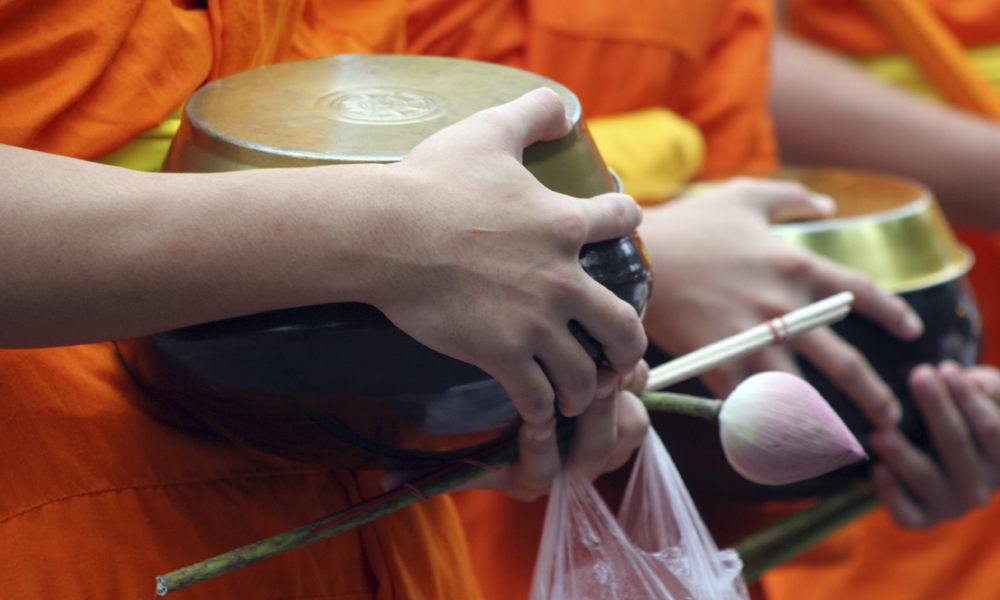 Bangkok to Chiang Mai tour: monk hold a pot and flower