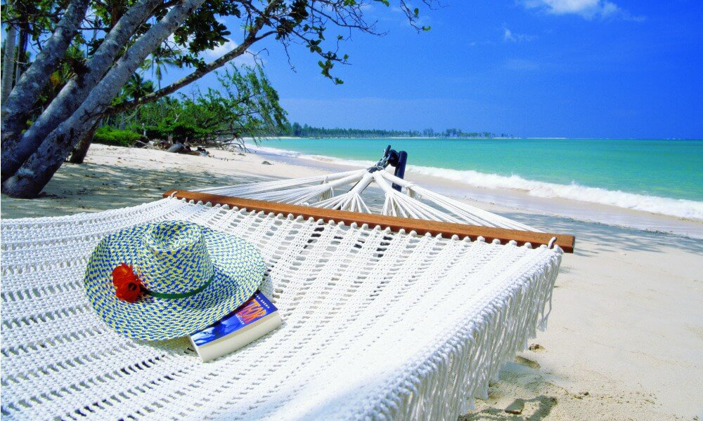private tour thailand: beach, hammock and sun hat