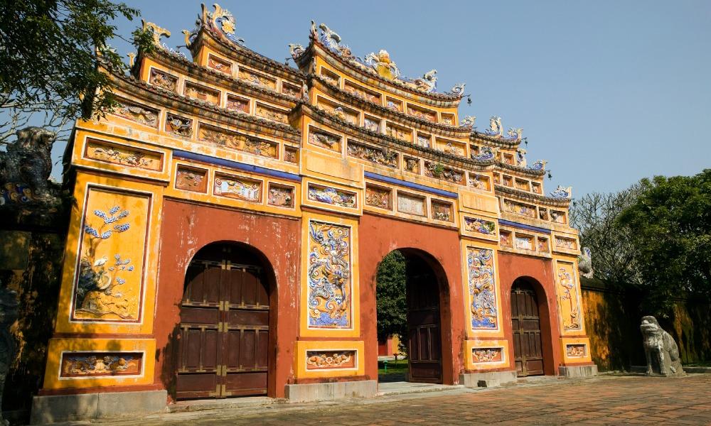 red yellow doorway gateway citadel forbidden purple city, hue in vietnam