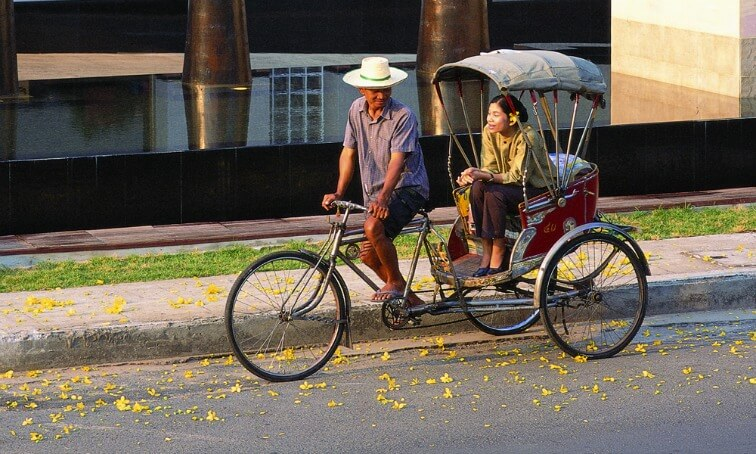 Chiang Mai Food Tour: Asian couple in a rick-shall bike