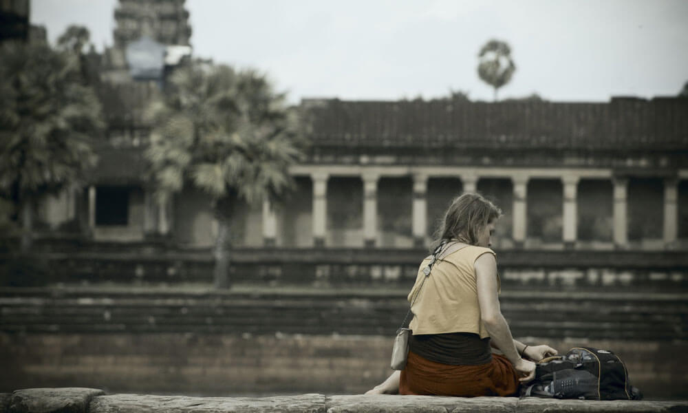 Ancient Angkor: tourist at Angkor Wat
