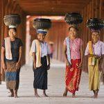 Myanmar – People – Burmese women carrying bowls of rice to the monastery