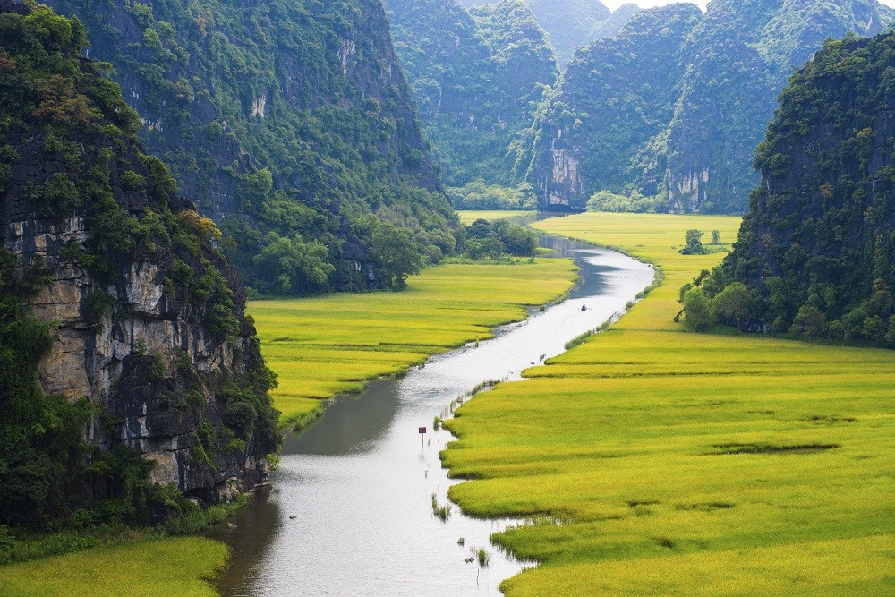 view of ninh bonh mountains and rivers where you can have a short cruise on a traditional boat