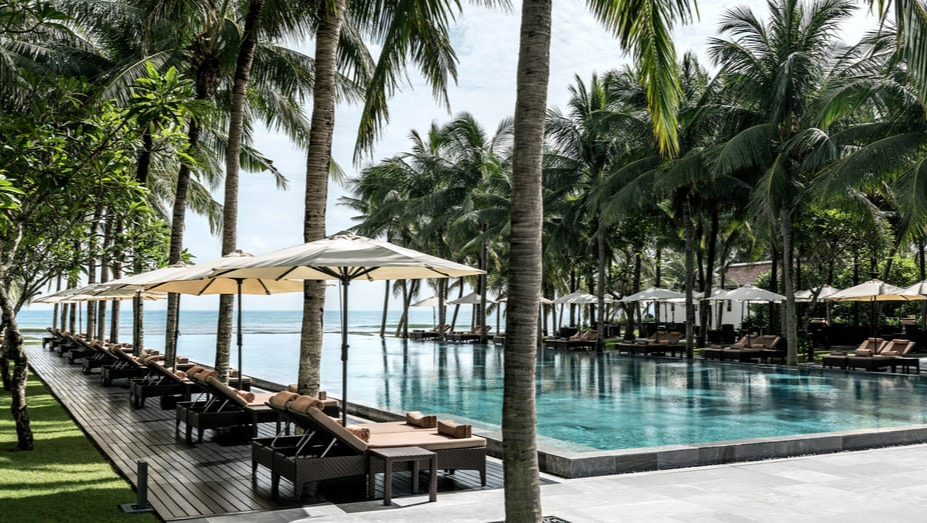 luxury resorts - Four Seasons the Nam Hai, Vietnam - swimming pool and beach view