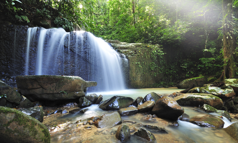 Best places to go in Malaysia with family: waterfall in Malaysian jungle Borneo Kota Kinabalu, Sabah