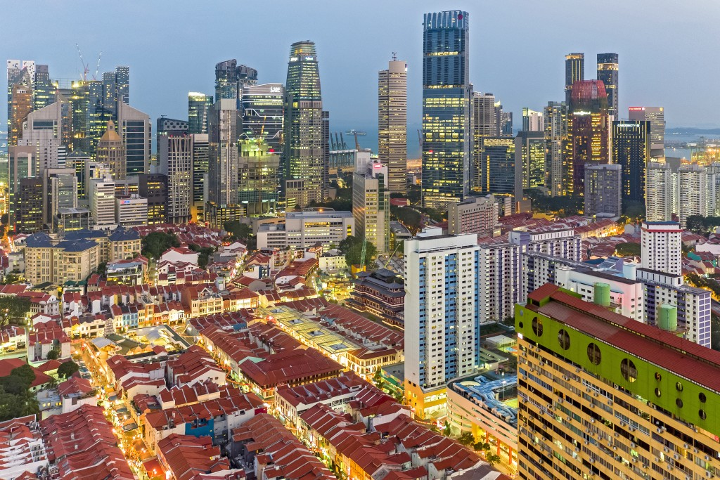 Icons of Singapore: Chinatown and Singapore city view at dusk